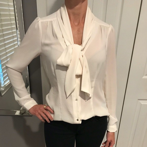 c18a2830 Ivory silk tie front blouse. M_5b8c9a651e2d2d5f79f6befc. Other Tops you may  like. White House Black Market ...
